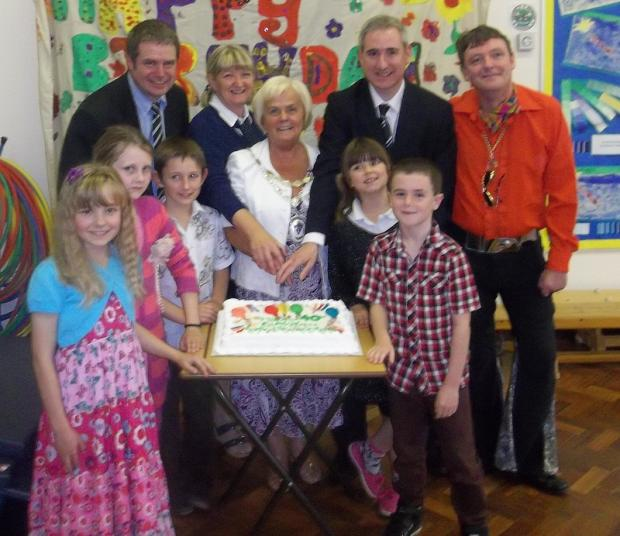 Ashfield Primary School celebrates its 40th anniversary with (back row, from left) governor Councillor Ryk Downes, headteacher Sybil Parker, Otley town mayor Councillor Mary Vickers, MP Greg Mulholland and governor Councillor Sandy Lay