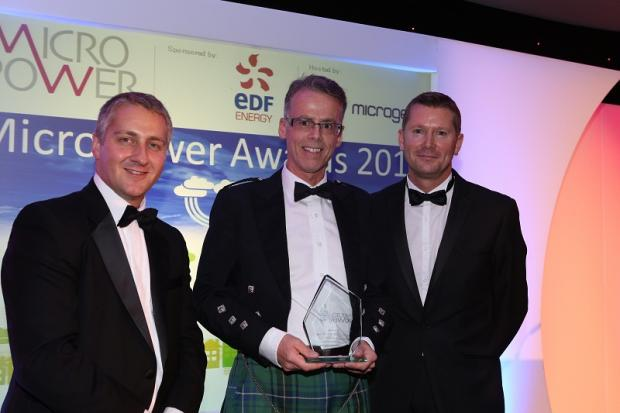 Ecoliving founder and director Mark Henderson receiving the award from Dave Sowden, the CEO of the Micropower Council, and Alan Whitehead MP