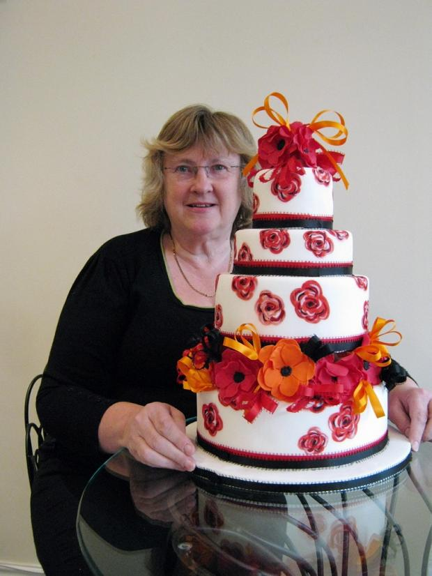 Pat Moore, of Moorish Cakes, with one of her creations, this time to mark the annual Poppy Appeal