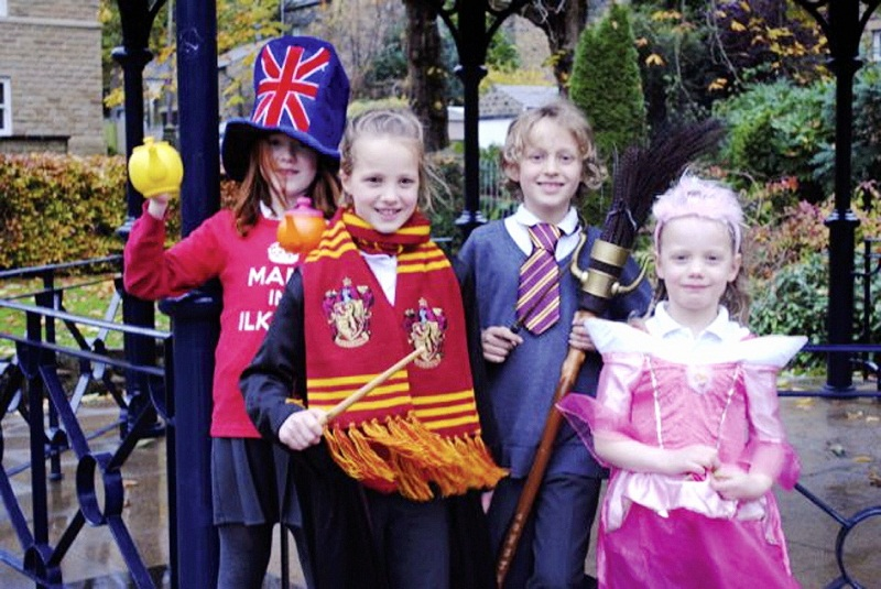 Daisy Gilroy-Bewell, eight, Neve Tennant, eight, Ben Johns, nine, and five-year-old Cara Tennant at the bandstand in The Grove, Ilkley, in some costumes from previous Ilkley Carnivals