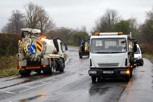 Ilkley Gazette: Highways staff pumped water away and cleared blocked drains on the A659