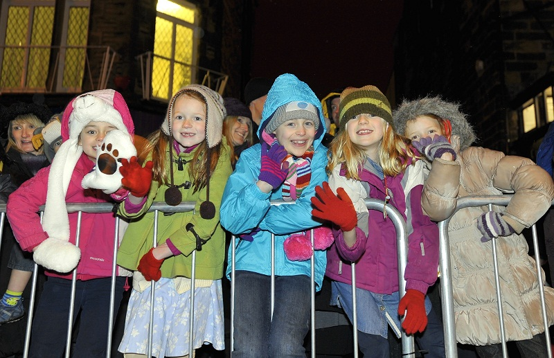 Well wrapped up, these smiling youngsters were among hundreds who saw the Christmas lights c