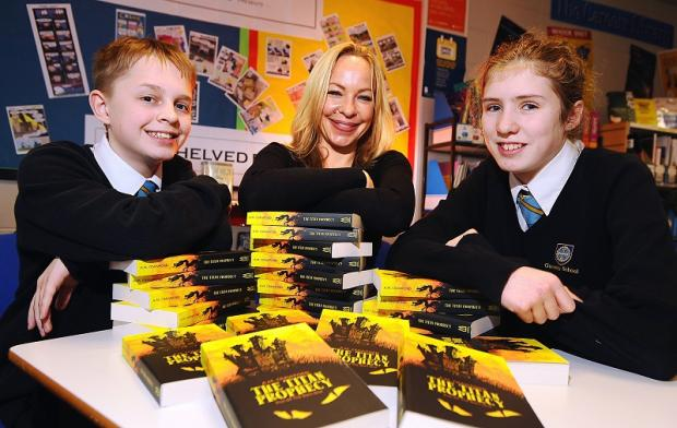 Author Antonia Crawford with Tom Marshall and Lydia Smith and her children's fantasy book