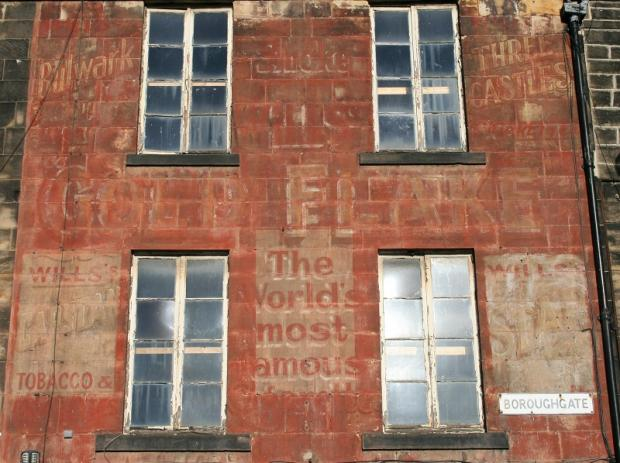 The Boroughgate building showing the faded wording from years gone by