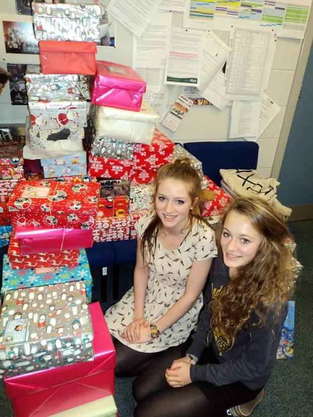 Students Sophia Eades-Jones and Hannah Brown with some of the boxes