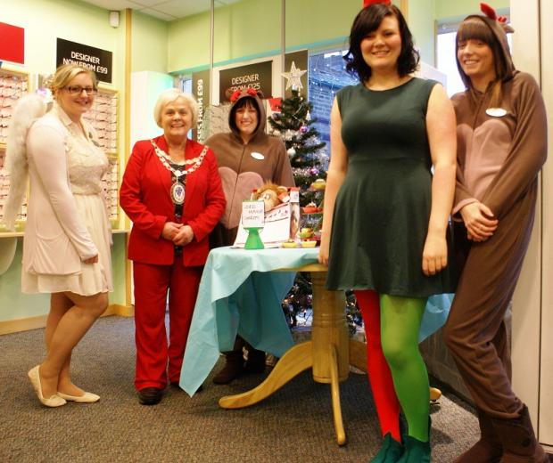Charlotte Kerr, town mayor Councillor Mary Vickers, manager Lindsey Williams, Lucy Prince and Shannydee Penn at the Specsavers store