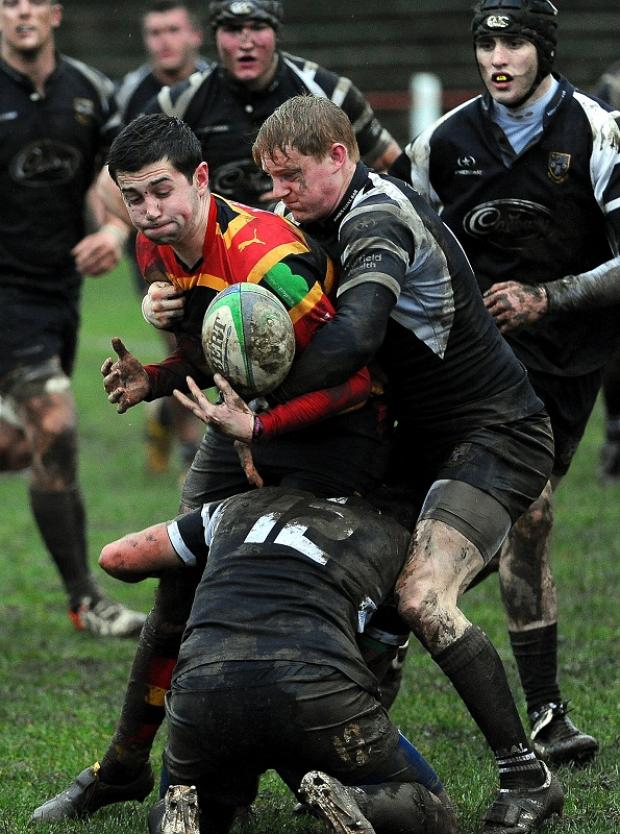 Otley's Ben Fairclough and Chris Gemmell combine to tackle Bradford & Bingley's Josh Seal in the Granville Clark memorial trophy match