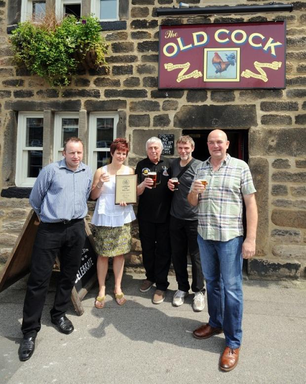 Pub manager Chris English celebrates with co-owner Linda Exley, John Rowe, from Leeds CAMRA, Dr Paul Briscoe, from Otley's Briscoe's Brewery, and  co-owner Lee Pullan