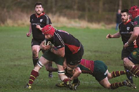 Steve Burns tries to break a tackle. Picture: ruggerpix.com
