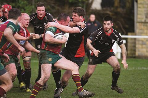 Ilkley Gazette: Ollie Renton mades a tackle watch by Iain McKenzie.Picture: reuggerpix.com
