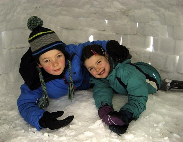 Jude and Amelie Brogden with their igloo at Middleton, Ilkley