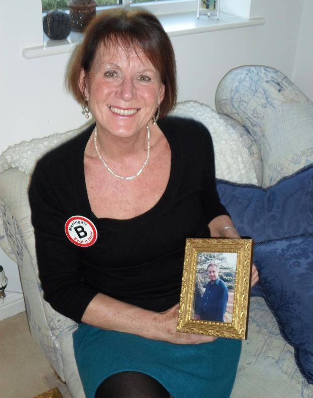 Lesley Leaver with a picture of her husband Kevin