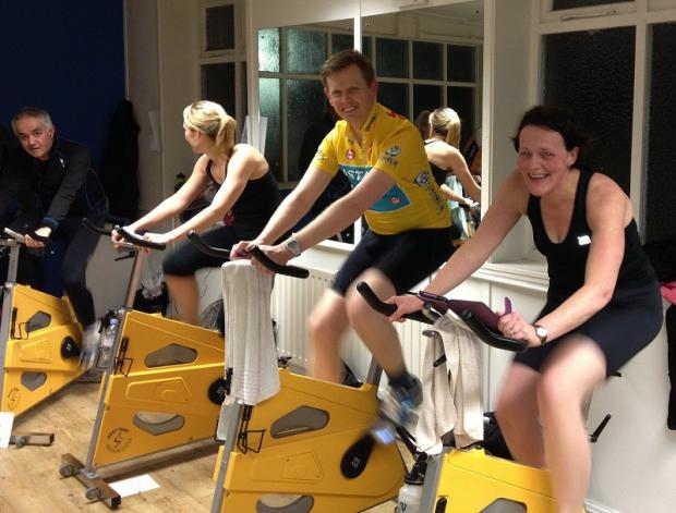 Beth Greewood, James Crawley and Fiona Sheen pedalling in aid of the charity Children with Cancer