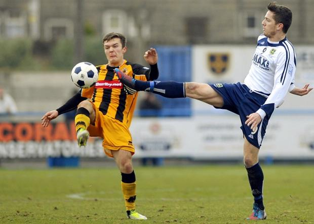 Josh Wilson, right, at full stretch for Guiseley against Boston