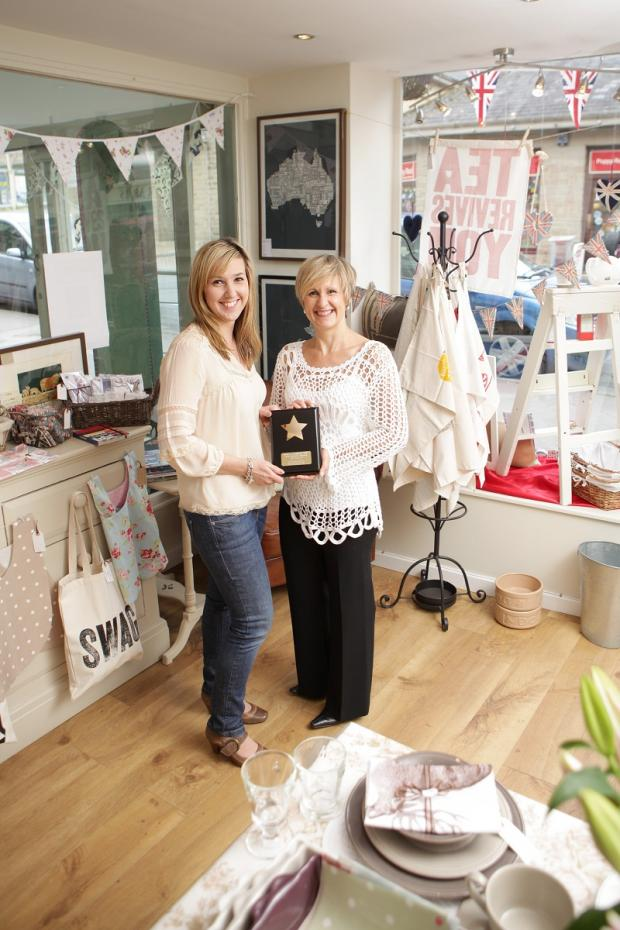 Suzanne Johns with Victoria Newhouse from Nora's Gifts, last year's winner of the shop window display competition