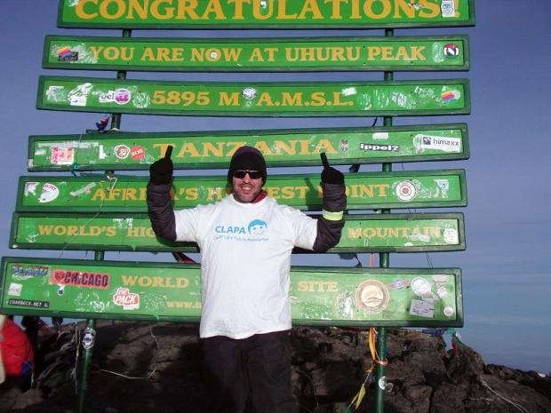 John Sinclair reaches his charity goal at the summit of Mount Kilimanjaro