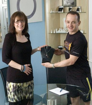 Founder of Brain Tumour Research, Carol Robertson, and jeweller Tim Swann with the diamond necklace