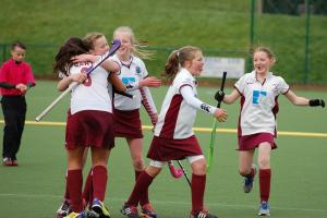 The Ben Rhydding girls under-12 hockey players celebrate winning a bronze medal at the National Finals.