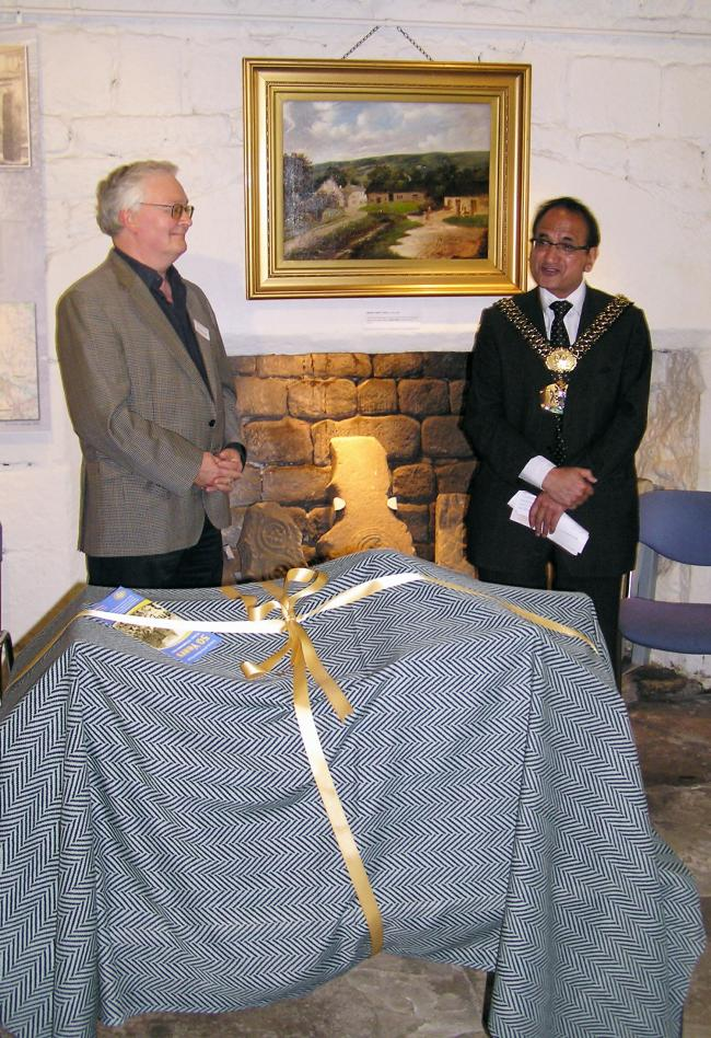 John Cockshott, of the Friends of the Manor House, with Lord Mayor of Bradford, Councillor Khadim Hussain, before unveiling the a model of the Manor House itself
