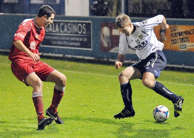Louie Swain, right, would have had much more opportunity with Guiseley had he been a centre back, admits Lions manager Mark Bower