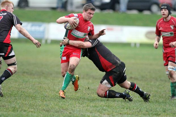 Ilkley Gazette: Keighley fly half and skipper Alex Brown is collared in midfield