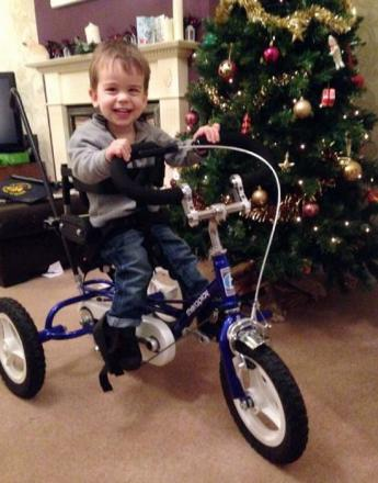 Wesley Knight enjoying riding his new, specially-designed tricycle