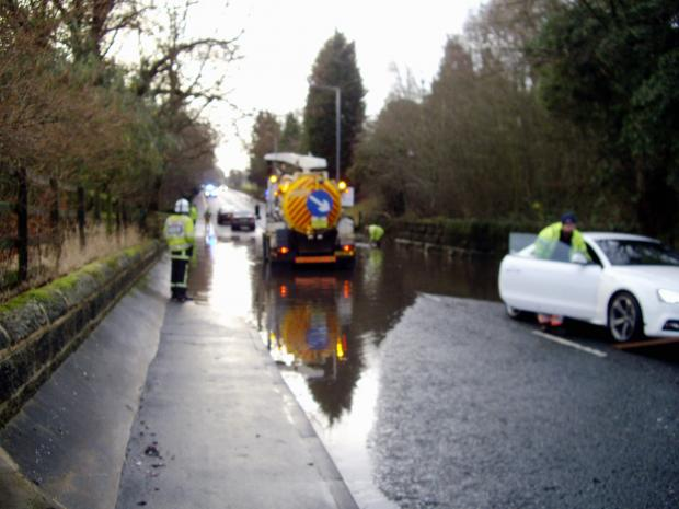 Ilkley Gazette: The flooded A65 between Menston and Burley-in-Wharfedale