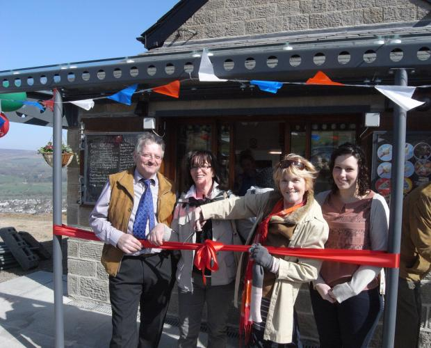 Ilkley Gazette: Cafe owner Toni Falconi, his sister Antonia Asconi, Councillor Anne Hawkesworth and Francesca Falconi, daughter of Mr Falconi, last year