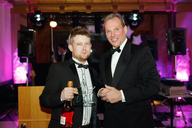 Head chef, Stuart Dixon, collecting his Hospitality Star of the Year award from chief executive officer Nick Sanderson