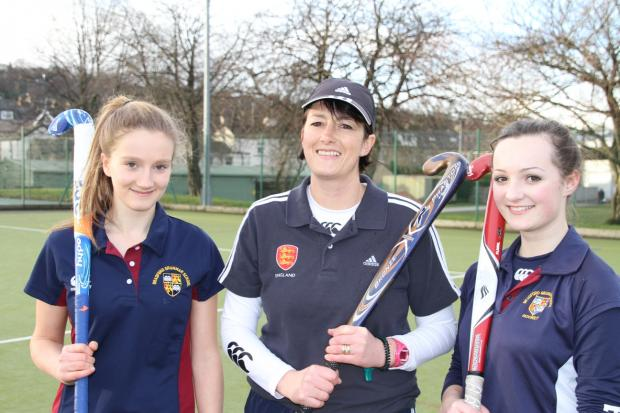 Coach Demy Dowley with young players Katie Boden and Georgina Hustler