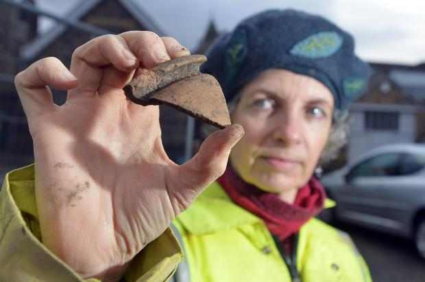 Ilkley Gazette: Caroline Emery holding a piece of what could be Roman storage jar