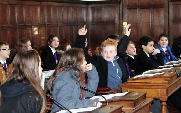 Ilkley Gazette: Charlie Harrison is keen to ask a question with other pupils Arthur Ashcroft, Pedram Habibzadeh, Nathanael Perkins, Joe Higgett, Amber Medway and Amelia Milner