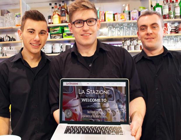 La Stazione manager and coffee artist in residence Max Crane, centre, showing off the new website with co-workers Jonny and Phil