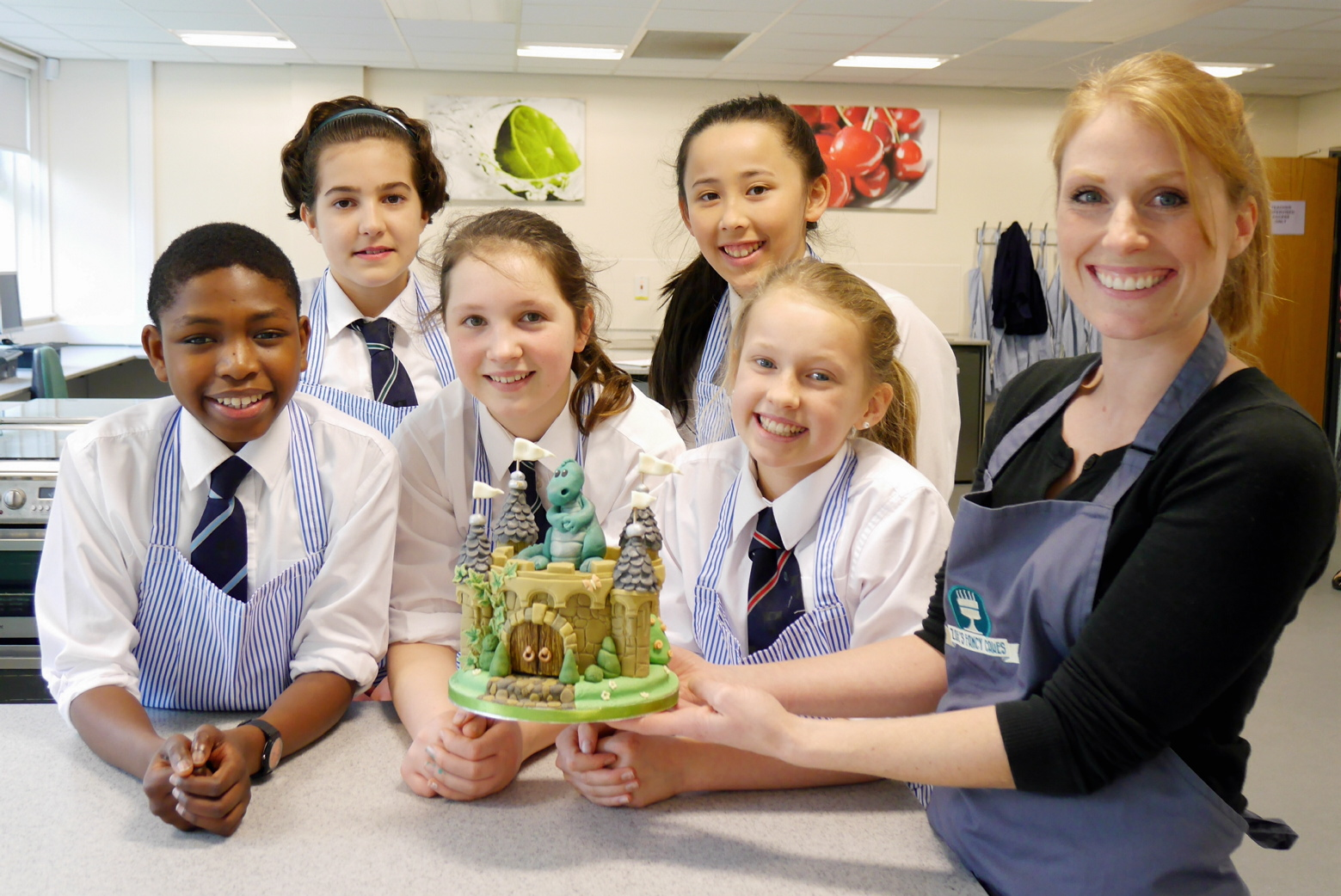 Zoe Hopkinson of Zoe's Fancy Cakes (far right) with year seven GSAL pupils, left to right, Toluwani Olusanga, Natalia