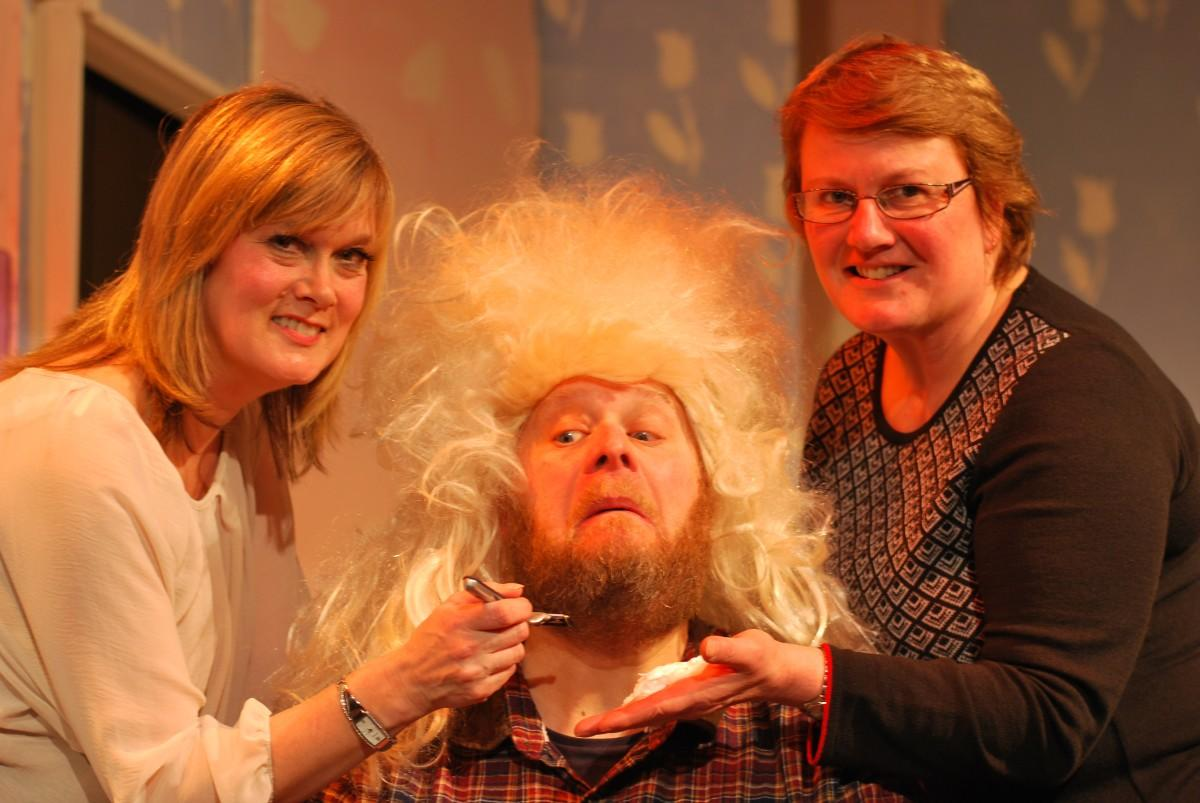 Director Eleanor Ellis and the musical director Vickie Burns take the drastic step of forcing the Dame (Paul Jennings) to lose his beard for the Adding