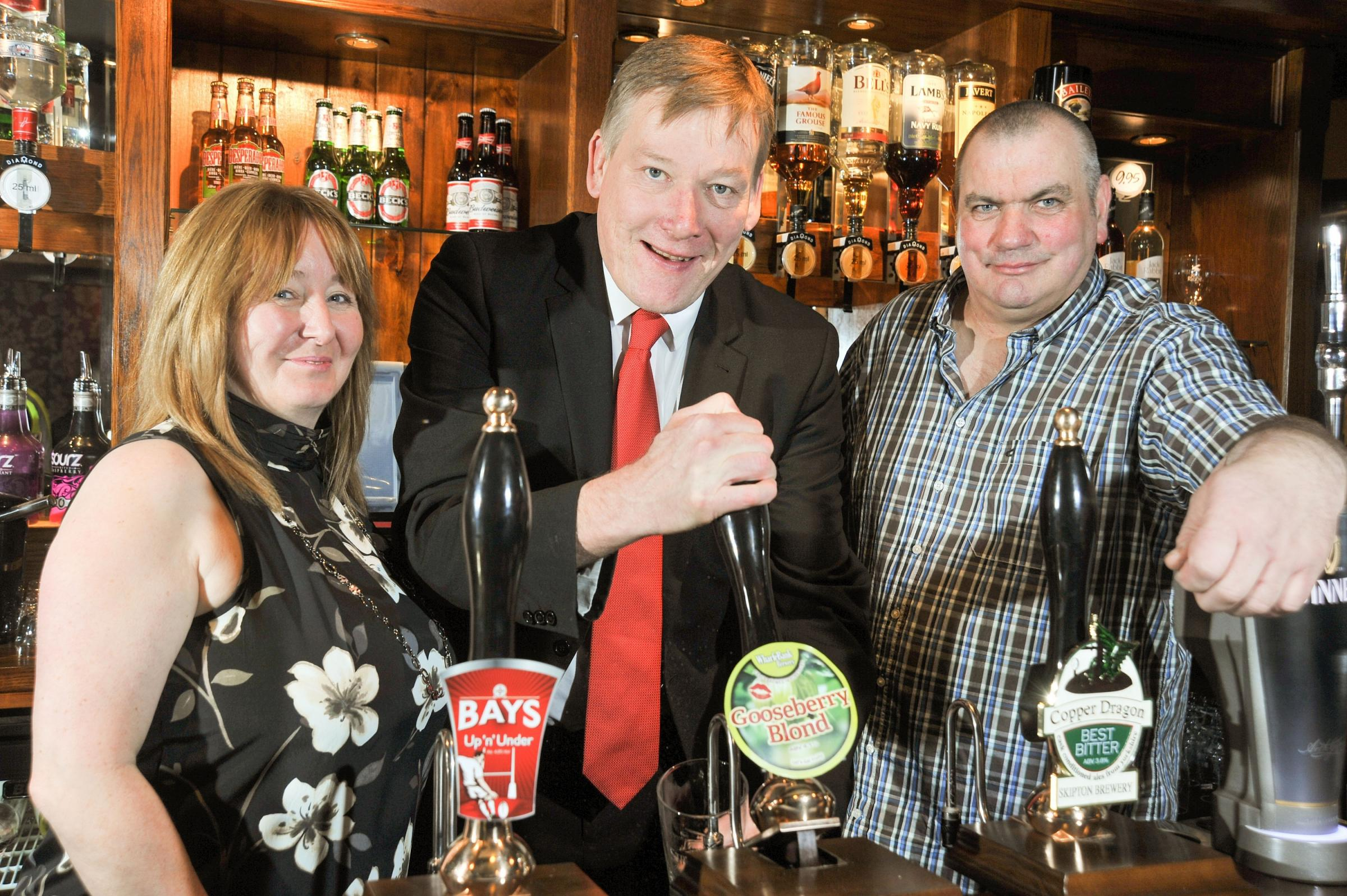 At the reopening of the Robin Hood pub in Silsden after its refurbishment, from left, licensee Sue Robinson, MP Kris Hopkins and licensee Darren Robinson