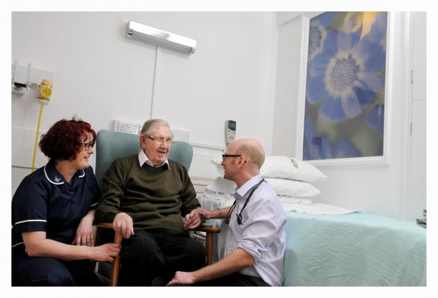 Ilkley Gazette: Pictured are Airedale Hospital Ward 6 sister Sarah Robinson with patient Ronald Ford and consultant Robert Marshall
