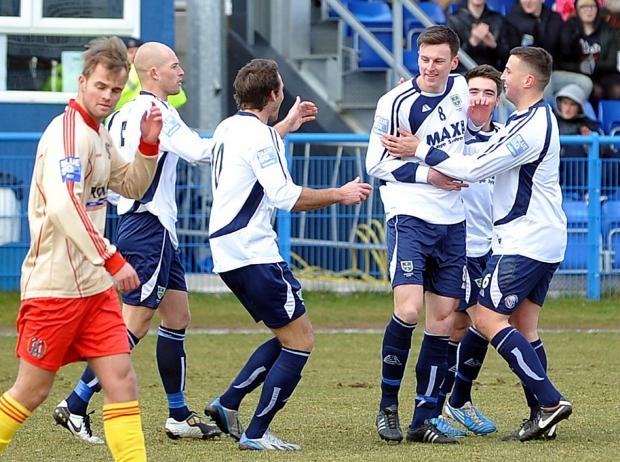 Ilkley Gazette: Jake Lawlor, third from left, opened the scoring for Guiseley in the 19th minute