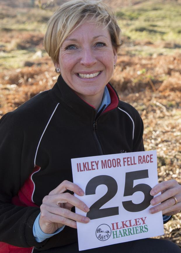 Ilkley Gazette: Celebrating 25 years of Ilkley Moor Fell Race: Chairman of Ilkley Harriers Jane Bryant. Picture by Anna Nolan