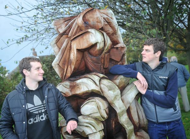 Alistair, left, and Jonny Brownlee at the unveiling of a statue entitled Triathlon in Bramhope in November