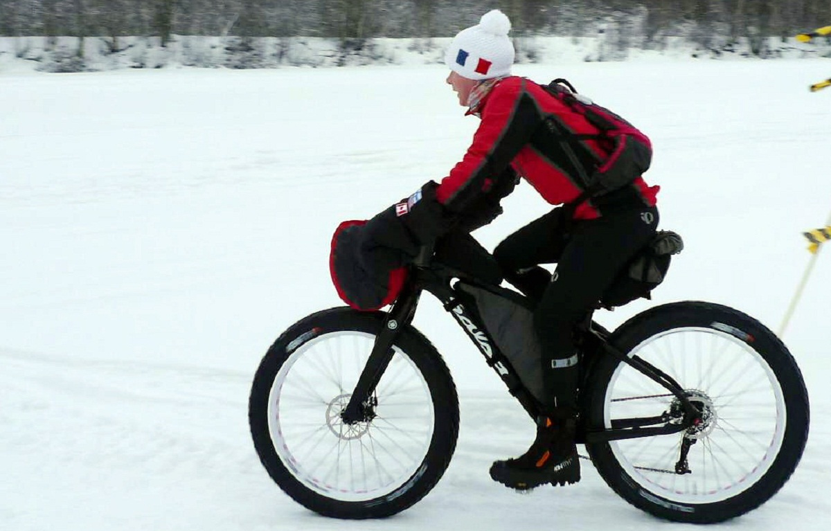 Extreme-bike enthusiast Jane Chadwick making her way through snow and freezing temperatures