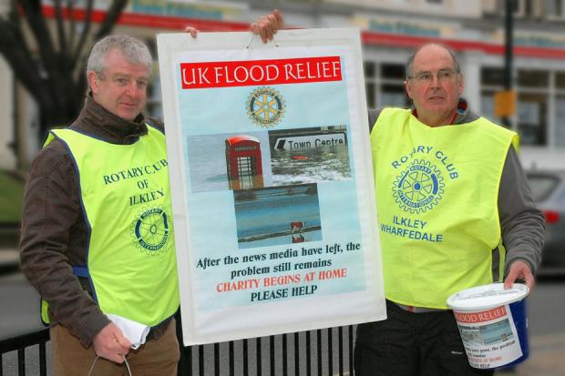 Vernon Young, left, of the Ilkley Rotary Club and Andrew Broughton, of the Ilkley Wharfedale Rotary Club, collect money from shoppers on The Grove in Ilkley for victims of the recent floods