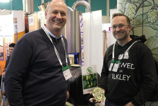 Ilkley Gazette: Paul Corbett, of Charles Faram and Co hop merchants, with Chris Ives, managing director of Ilkley Brewery, at SIBA BeerX where the Olicana hop was unveiled