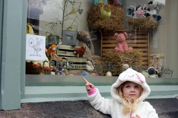 Heidi Emery, aged two, spots an Easter bunny in one of the shops windows in Addingham