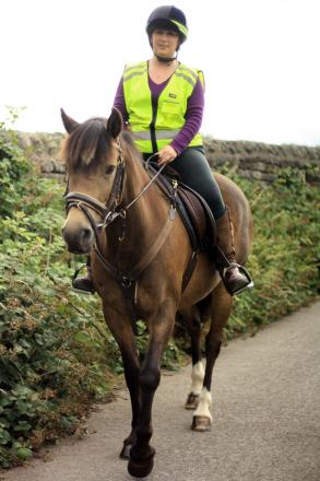 Carrie Emmerson riding her horse Ellie