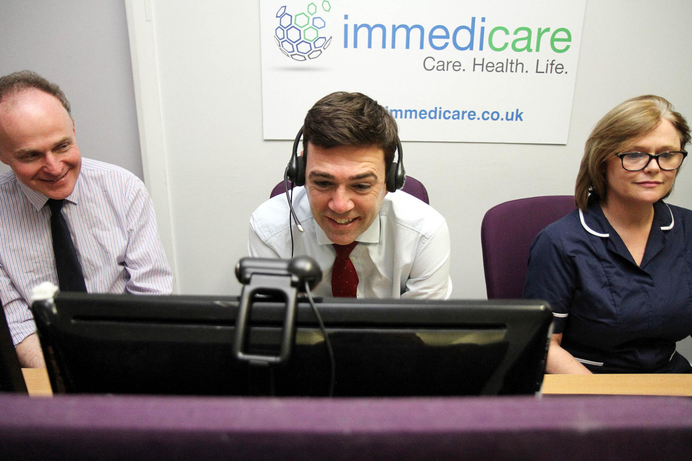 Shadow health secretary Andy Burnham uses the telemedicine system to talk to a patient, with Labour parliamentary candidate for Ilkley and Keighley John Grogan and Sister Alex Blake