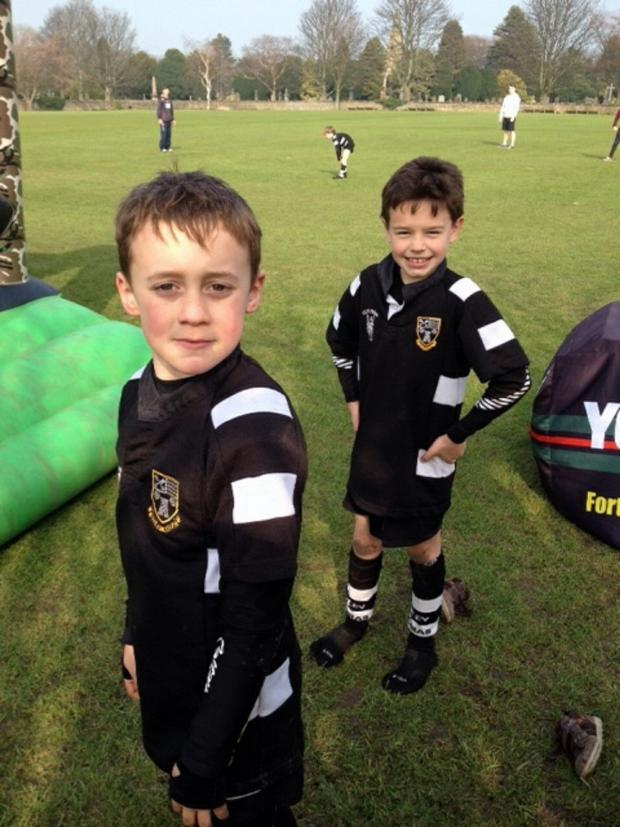 Ilkley Gazette: A pair of young players enjoying themselves at the rugby club's open day