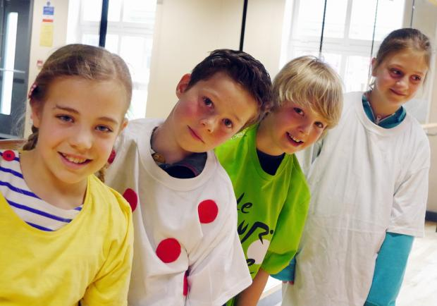 Pupils from Ashlands School in Ilkley wear the yellow, green, white and polka dot jerseys to celebrate the T