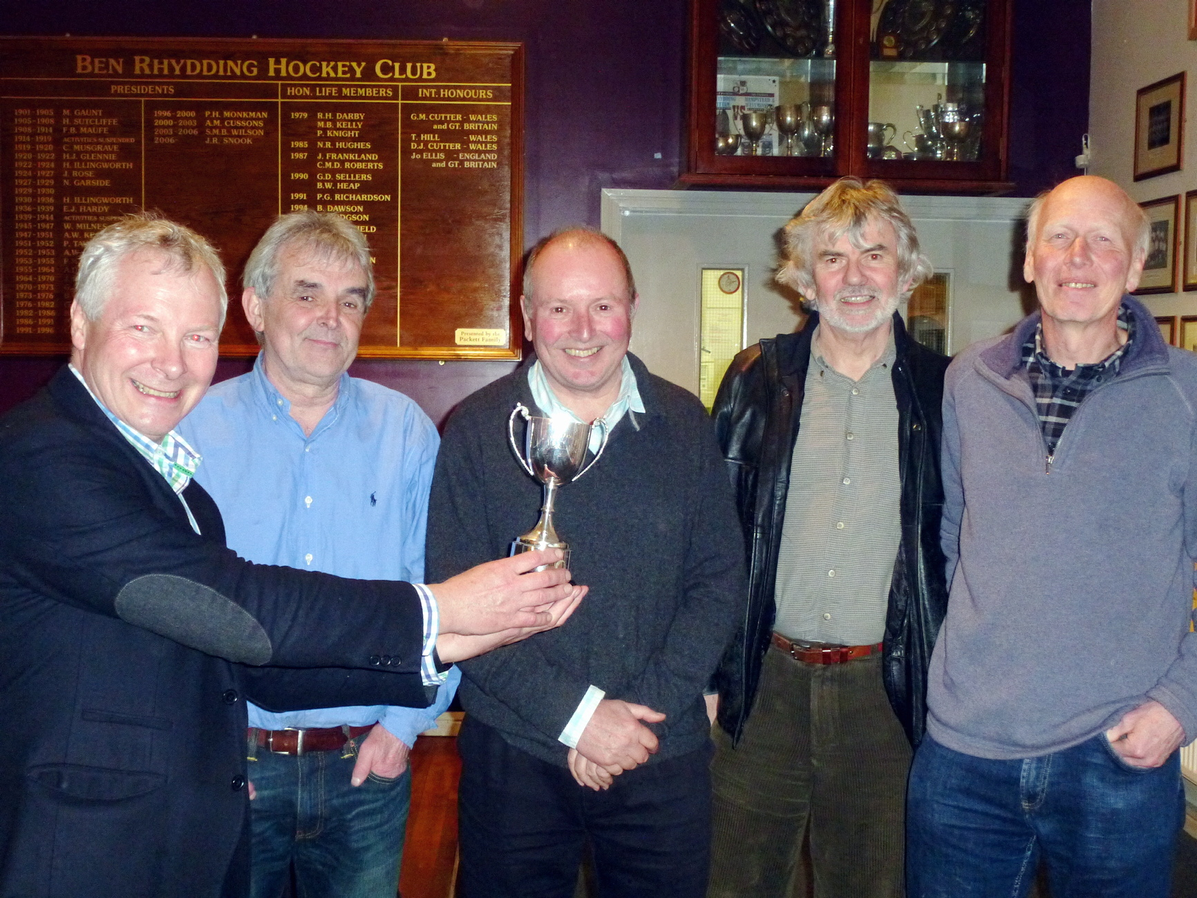 Ian Briggs of the Rotary Club of Ilkley (far left) presents the Andrew Hartley Cup to the winners of the business quiz, a team from Allison & MacRae Architects of Burley-in-Wharfedale, from left Steve Nicholson, Mi