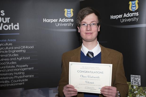 Student Oliver Wadsworth, 19, from Burley-in-Wharfedale, with his Velcourt Dairy Scholarship during a ceremony at Harper Adams University